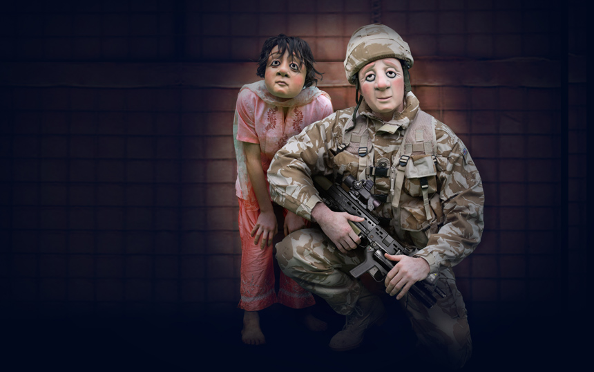 Soldier with little afghan girl