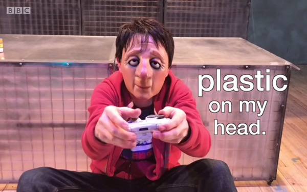Ryan plays a video game