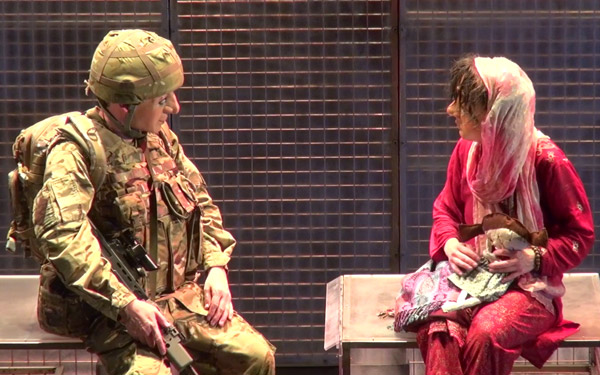 Girl and soldier sit together