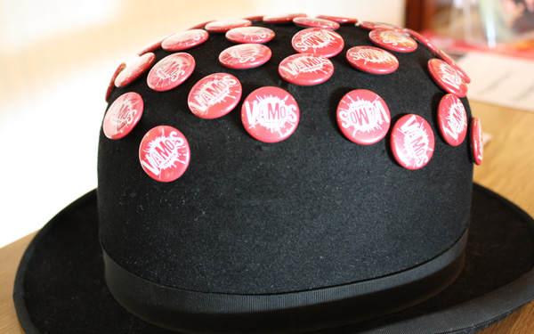 A bowler hat with badges on