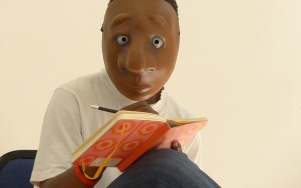 A boy writes in a book