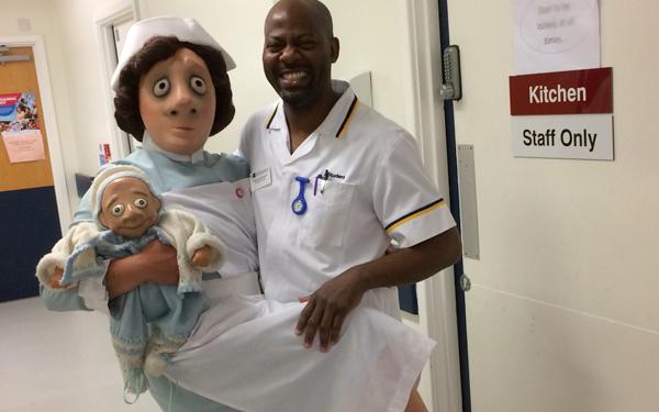 A nurse mask character with a male nurse