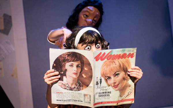 Mask character reads magazine at hairdressers