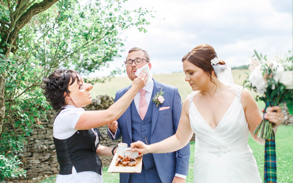 Waiter with bride and groom