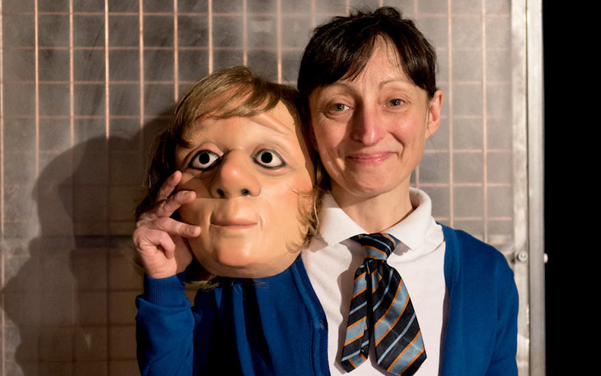 Joanna Holden holds one of the masks she wears