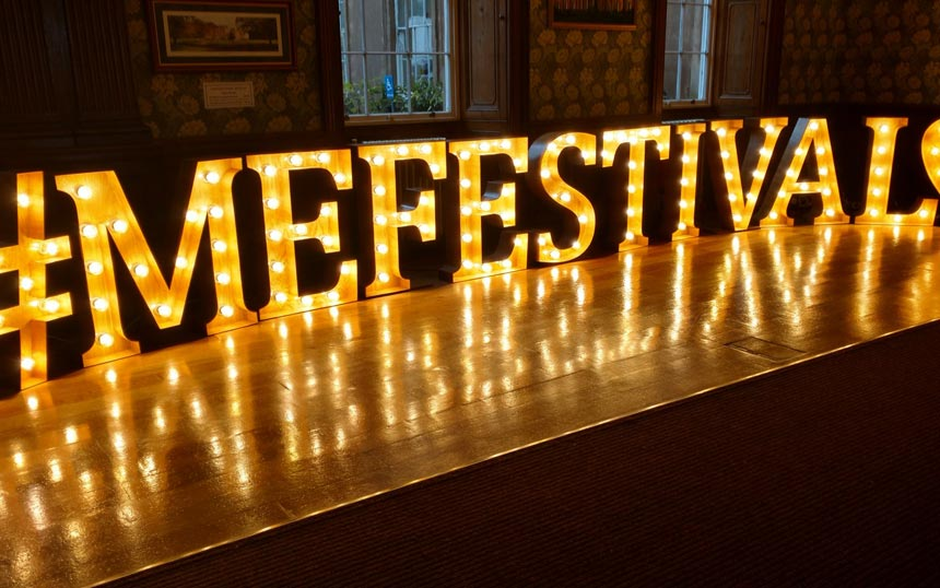 The words #MEFESTIVAL displayed in lights