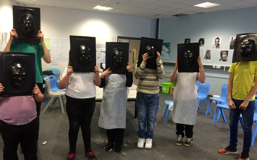 Group of Ganton School students hold up their mask molds