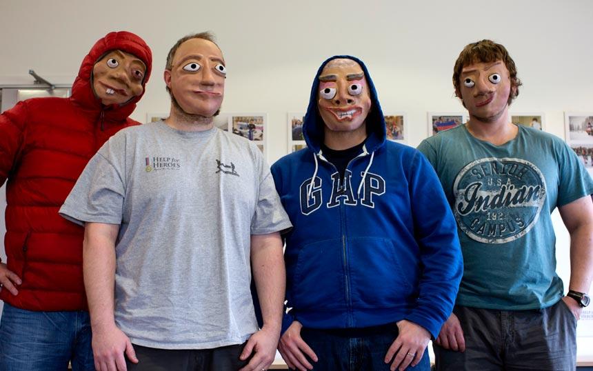 Four Veterans wearing their masks