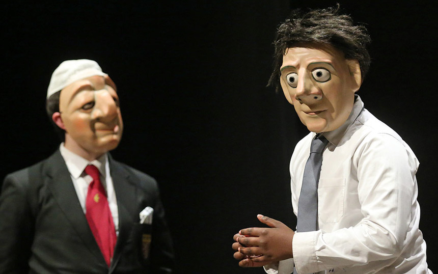 Two mask performers talking