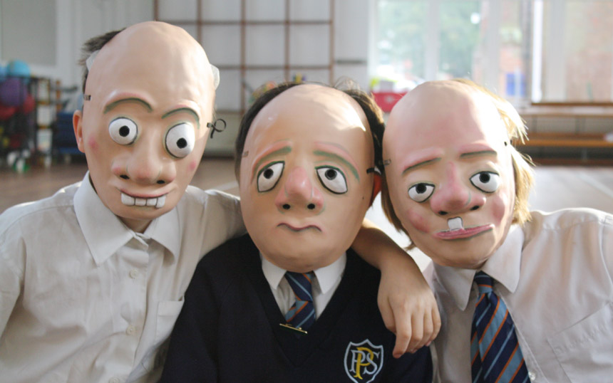 Three pupils with their masks on