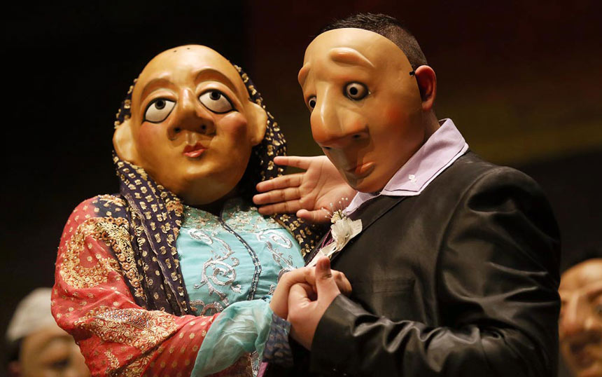 two mask students dance