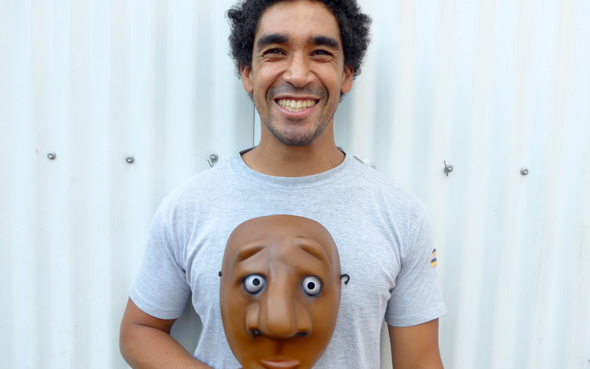 Smiling male actor holds a mask