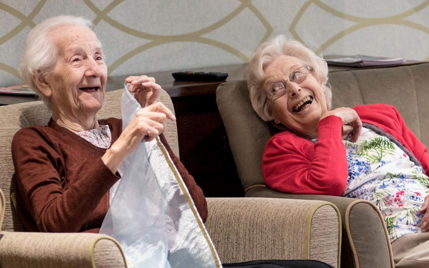 Two older ladies laughing