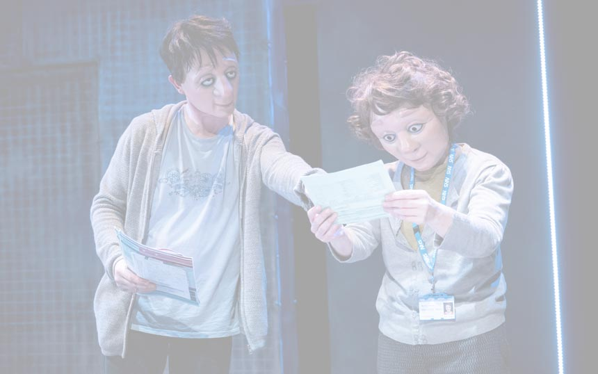 Two characters look at paperwork