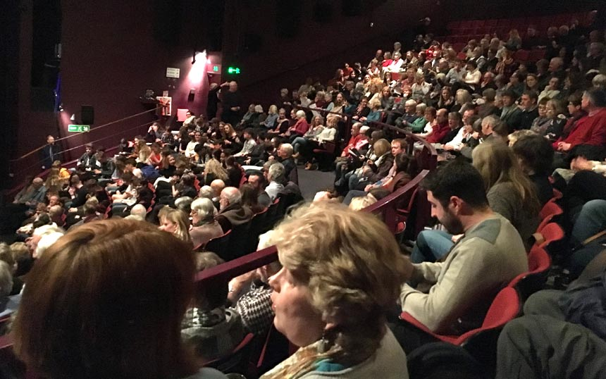 A photo of the audience at a psot show discussion