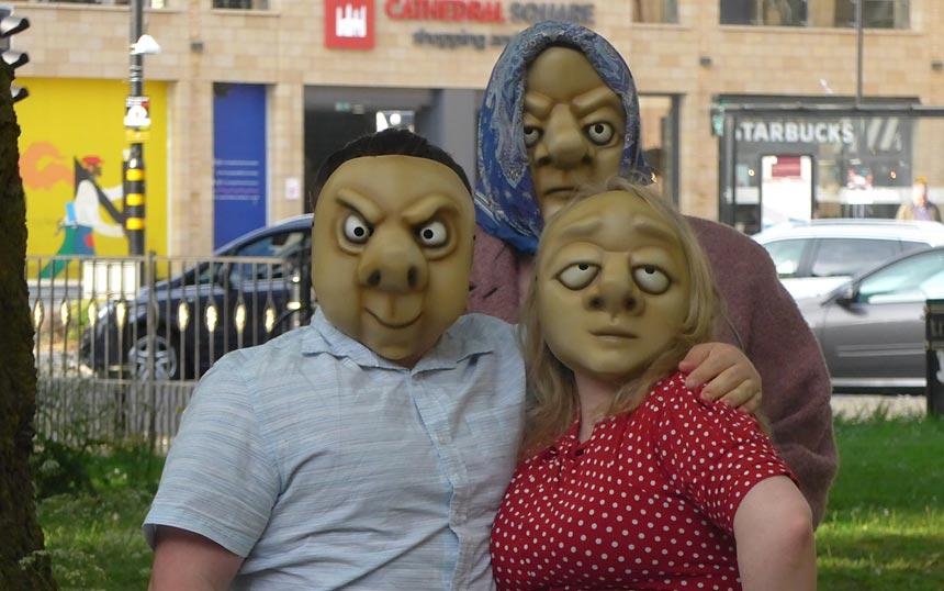 3 members of Vamos Central in mask