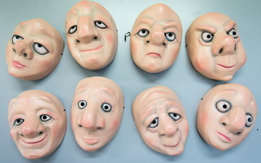 a line up of Vamos Theatre masks on a table