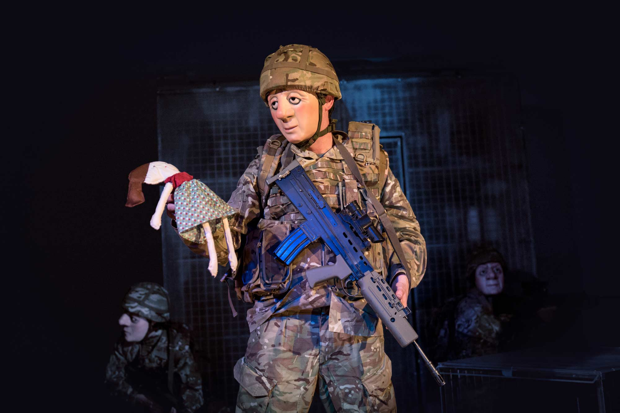 Soldier holds a rag doll