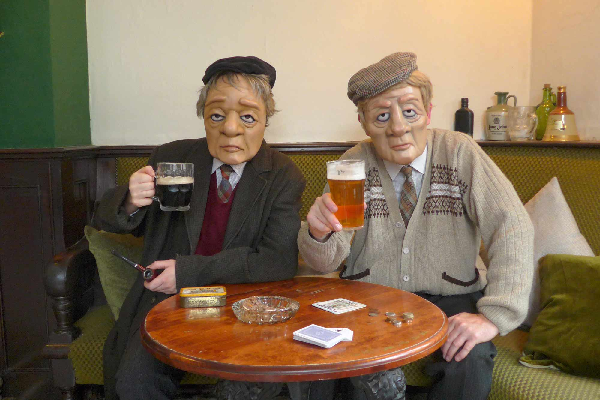 Two older men say cheers
