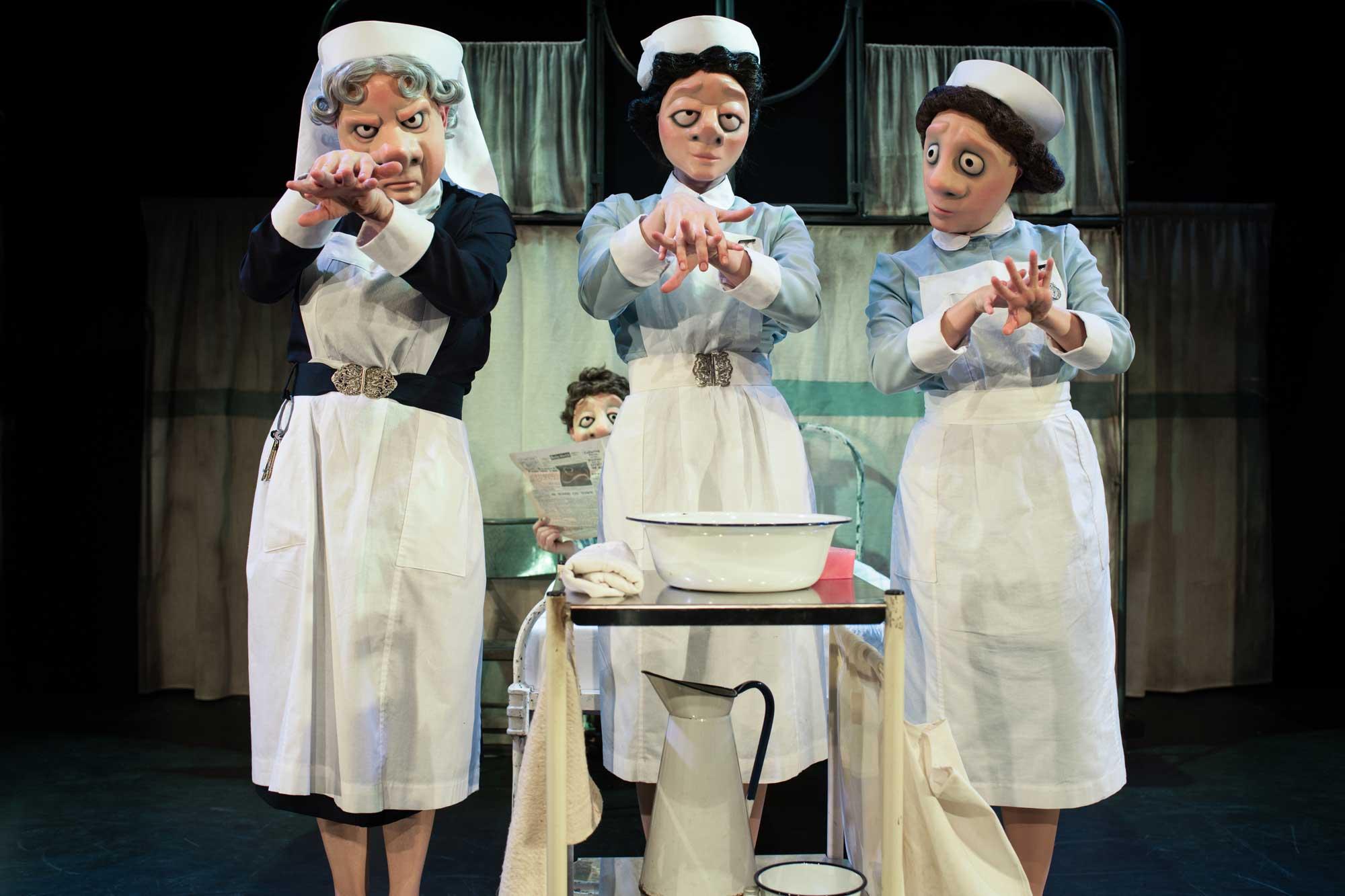 Three nurses washing hands