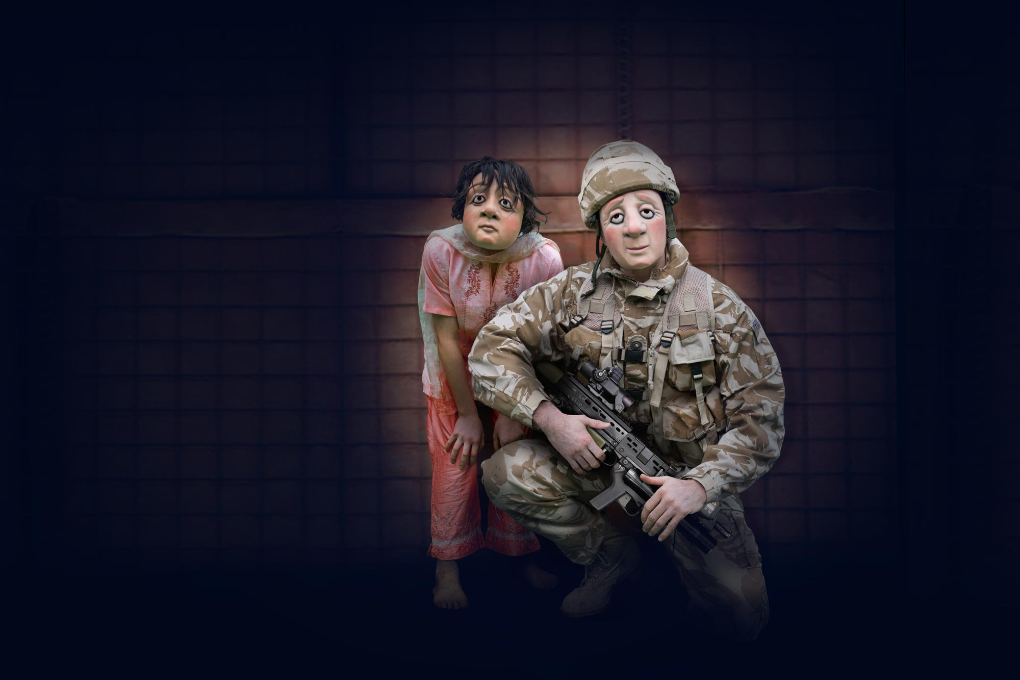 Little girl stands next to soldier